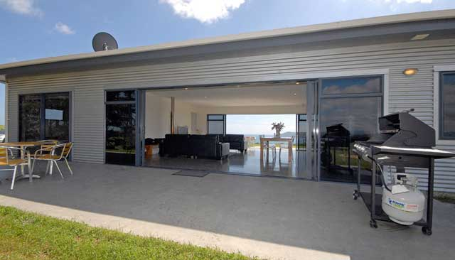 Flat roof house designs nz house and home design for Best small house designs nz